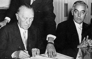 Adenauer signs the Luxemburg agreement, 1952 (photo: Moshe Sharet Heritage Society)